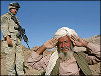 Afghan villagers being stopped by US soldier in Helmand province