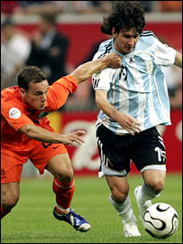 Argentina's Lionel Messi and Wesley Sneijder of Holland