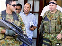 Australian peacekeepers guard Rogerio Lobato as he arrives at court