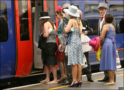 Race-goers boarding a train at Waterloo station