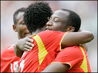 Ghana players celebrate the first goal