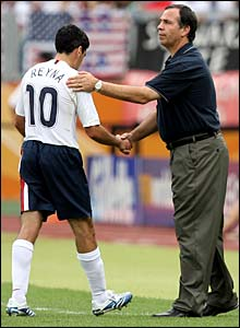 Claudio Reyna shakes hands with coach Bruce Arena