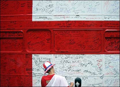A fan is pictured in front of the 'England wall'