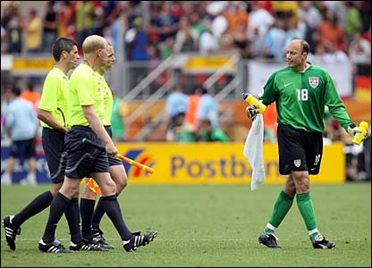 USA keeper Keller remonstrates with the match officials