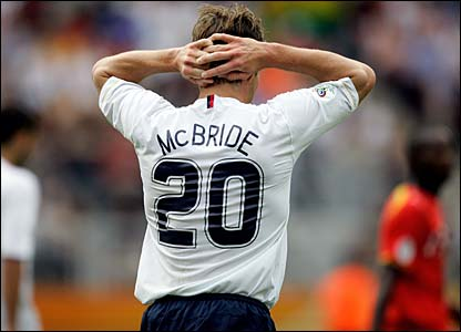 Brian McBride holds his head