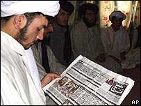 Afghan man reads newspaper
