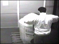 Mr Khyam appears to peer into a 600kg bag of fertiliser