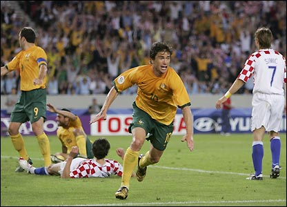 Harry Kewell scores the fourth goal of the match