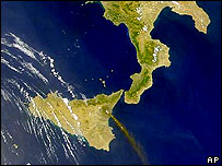 Satellite image of southern Italy and Sicily, showing a plume of ash above Mount Etna