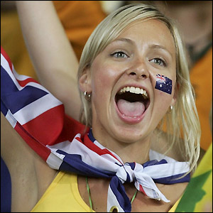 An Australia fan celebrates qualification for the last 16