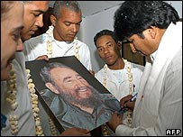 President Morales autographs a portrait of Cuba's Fidel Castro for a group of Cuban doctors