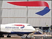 BA plane moving past hangar