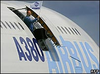 Airbus employee leaning out of an A380