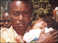 Julia Kanuu, mother of Pamela, holding her three-month-old daughter, Janet
