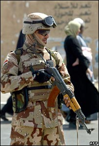 An Iraqi soldier secures an area in central Baghdad