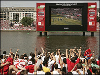 England supporters watch a giant screen