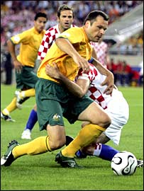 Australia's Mark Viduka is brought down by Croatia's Josip Simunic