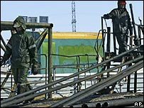 Workers at a Rosneft oil field previously owned by Yukos