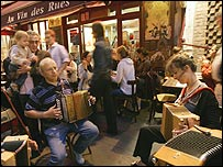 French musicians perform outside a restaurant in Paris