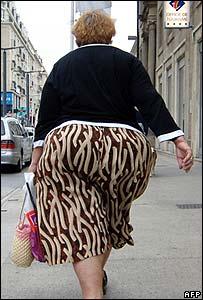 An overweight woman walks down the street in Caen, western France