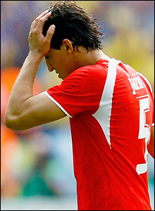 Jaziri holds his head after receiving a red card