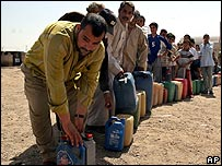 Iraqi's queue for fuel