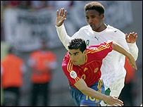 Jose Antonio Reyes of Spain is challenged by Mohammed Noor
