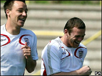 Rooney and Terry in training