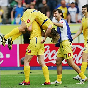Ukraine's players celebrate victory and qualification