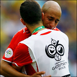 Mehdi Nafti is consoled after Tunisia's exit from the World Cup is confirmed