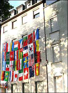 Flags of all nations hang on a building