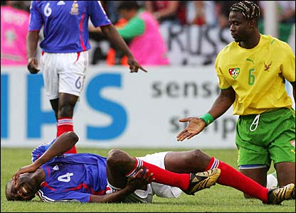 Patrick Vieira in pain after a tackle from Yao Aziawonou