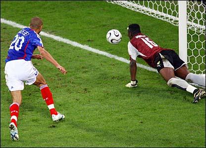 Goalkeeper Kossi Agassa saves from David Trezeguet