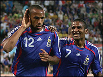 Thierry Henry celebrates his goal with Florent Malouda