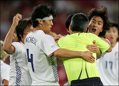 South Korea remonstrate with the referee