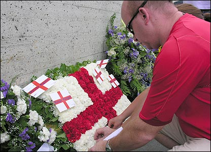 John Lawrence adding his tribute to the England wreath