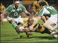 George Gregan scores one of Australia's five tries against Ireland