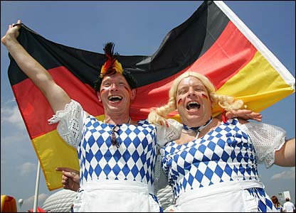 Two Germany fans dressed up as milk-maids