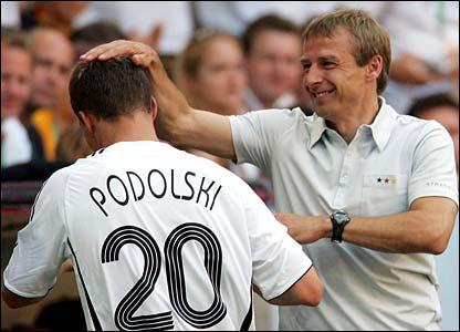 Jurgen Klinsmann congratulates Lukas Podolski