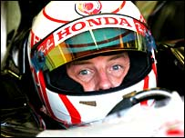 Britain's Jenson Button is focused during qualifying