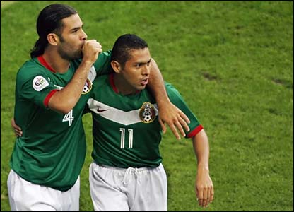 Mexico's Rafael Marquez celebrates with Ramon Morales