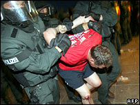 An England fan is taken away by riot police