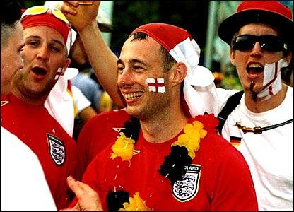 England fans celebrate the German victory