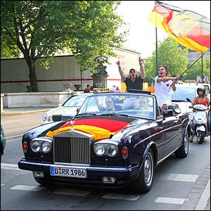 German fans in a car bearing their national flag
