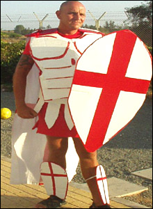 An English 'gladiator' poses in St George style regalia