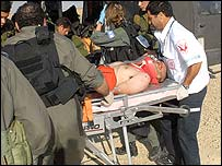Injured Israeli soldier being put onto helicopter