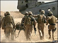 US troops in Iraq rush a wounded Marine to a helicopter