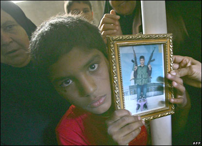 A relative of Hamed al-Rantissi shows the picture of the militant, killed during a raid against Israel.