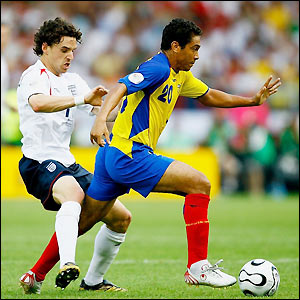 Edwin Tenorio attempts to bring the ball away from Owen Hargreaves
