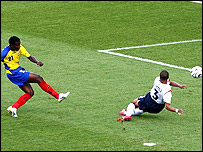 Ashley Cole deflects Carlos Tenorio's early shot onto the England crossbar